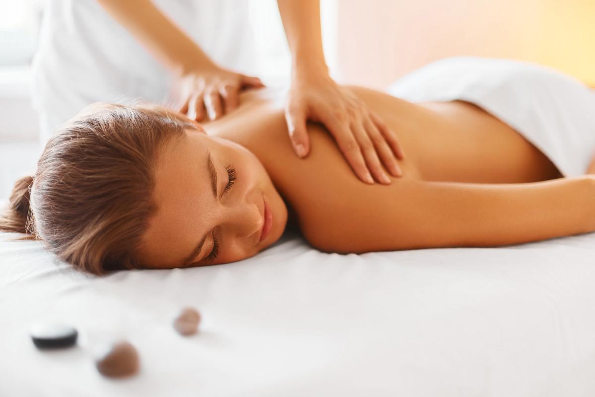 Spa woman. Female enjoying massage in spa centre.
